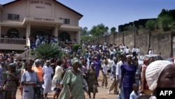 FILE - Several hundred Sierra Leoneans leave a church in Freetown.