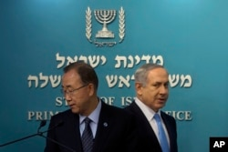 United Nations Secretary-General Ban Ki-moon, left, and Israeli Prime Minister Benjamin Netanyahu, arrive to a press conference at the Prime Minister's office in Jerusalem, Oct. 20, 2015.