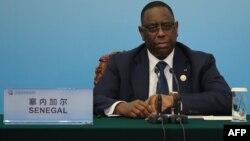 Le président sénégalais Macky Sall lors d'une conférence de presse conjointe dans le cadre du Forum sur la coopération sino-africaine au Grand Palais du Peuple à Beijing, le 4 septembre 2018.