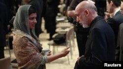 Pokiston tashqi ishlar vaziri Xina Rabboniy Xar Afg'oniston prezidenti Hamid Karzay bilan