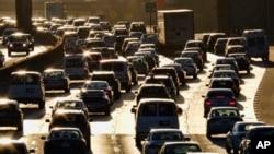 FILE - Morning rush hour traffic makes its way along US 101 near downtown Los Angeles, California, Nov. 15, 2016.