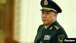 2014年3月10日,中国武警部队司令员王建平在北京开会