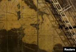 Part of a map showing the central Mediterranean is seen in the map room at the Combined Operations Center, dating back to World War II, in the War Headquarters tunnels beneath Valletta, Malta, March 24, 2017.