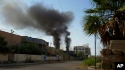 Smoke rises after bombing targets Islamic State positions in Fallujah, Iraq, May 24, 2016. The humanitarian situation in the city is reportedly desperate, with no safe routes for civilians to escape.