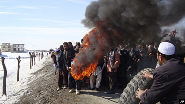 Afghans burn tires during an anti-U.S. demonstration over burning of Qurans at a US military base, in Muhammad Agha, Logar province south of Kabul, Afghanistan, February 25, 2012.