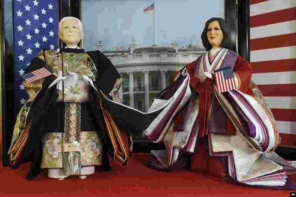 """Hina"" dolls depicting U.S. President Joe Biden and Vice President Kamala Harris are displayed for Girls' Day celebrations at Kyugetsu, a Japanese traditional doll company, Tokyo."