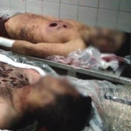 The bodies of young men the government says are soldiers killed near Damascus, January 2012.
