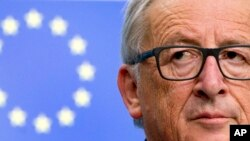 European Commission President Jean-Claude Juncker listens to questions during a media conference at the conclusion of an EU summit in Brussels, Oct. 20, 2017.