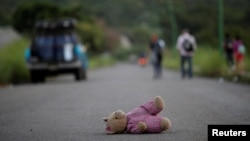 A doll of Central American migrant, part of a caravan trying to reach the U.S., is pictured along the highway to Arriaga from Pijijiapan, Mexico, Oct. 26, 2018.