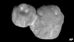 FILE- This Jan. 1, 2019, file image made available by NASA shows the Kuiper belt object Ultima Thule, about 1 billion miles beyond Pluto, encountered by the New Horizons spacecraft.