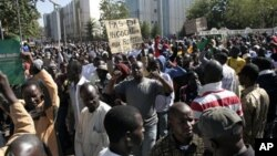 Malians demonstrate in capital Bamako to call for international military intervention to regain control of country's Islamist-controlled north Dec. 8, 2012