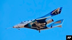 Virgin Galactic reaches space for the first time during its 4th powered flight from Mojave, Calif.