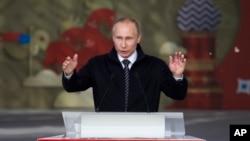 FILE - Russian President Vladimir Putin addresses Russian volunteers in Moscow, June 1, 2016.