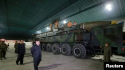 North Korean leader Kim Jong Un inspects the intercontinental ballistic missile Hwasong-14 in this undated photo released by North Korea's Korean Central News Agency (KCNA) in Pyongyang July 5, 2017.
