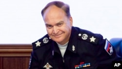 FILE - Russian Deputy Defense Minister Anatoly Antonov smiles at a briefing in the Defense Ministry in Moscow, Russia.