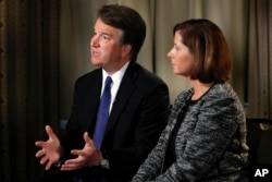 FILE - Brett Kavanaugh, with his wife Ashley Estes Kavanaugh, answers questions during a FOX News interview in Washington, Sept. 24, 2018, about allegations of sexual misconduct against the Supreme Court nominee.