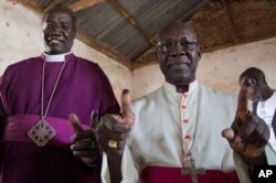 Archbishop Daniel Deng Bul of the Episcopal Church of Sudan (left) and Catholic Archbishop Paulino Lukudu Loro vote in the referendum on independence.