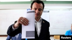 FILE - Albin Kurti, leader of the Vetevendosje (Self-determination) political party, casts his vote at a polling station in the capital city Pristina, June 8, 2014.