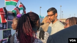 Google CEO Sundar Pichai speaks with teams of girl coders Thursday at Google's campus in Mountain View, Calififornia, August 10, 2017, as part of an international girl coding competition. (M. Quinn/VOA)