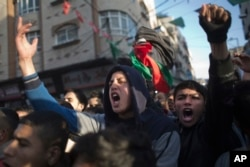 Palestinians chant in protest during a demonstration against the chronic power cuts in Jabaliya refugee camp, northern Gaza Strip, Jan. 12, 2017.