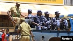 FILE - Ugandan policemen are seen on a truck.