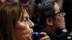 A woman blows a whistle during a protest against the president of Serbia in 2018. (AP Photo/Darko Vojinovic)