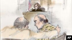 This courtroom sketch shows Nakoula Basseley Nakoula talking with his attorney Steven Seiden, left, as U.S. Central District Chief Magistrate Judge Suzanne Segal presides over the proceeding in Los Angeles, California, September 27, 2012.