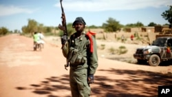 A Malian soldier mans a checkpoint on the outskirt of Diabaly, some 460kms (320 miles) north of Bamako, January 21, 2013.