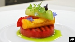This June 19, 2006 file photo shows an appetizer of grilled watermelon topped with tomatoes, basil and aged balsamic vinegar at Eleven Madison Park in New York. The restaurant announced it will no longer serve meat. (AP Photo/Richard Drew, File)