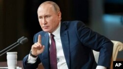 Russia Putin Russian President Vladimir Putin gestures during his annual news conference in Moscow, Russia, Thursday, Dec. 19, 2019