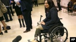 Representative Tammy Duckworth, a veteran of the war in Iraq, speaks with the media on Capitol Hill in Washington, DC, Nov. 14, 2012. (AP Photo/Pablo Martinez Monsivais)