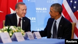 FILE - U.S. President Barack Obama hosts a bilateral meeting with Turkey's President Tayyip Erdogan during the NATO Summit in Newport, Wales, Sept. 2014.