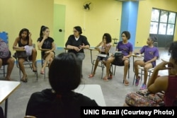"Young girls participate in a ""One Win Leads to Another"" workshop about leadership and self-esteem, sexual and reproductive health and rights, ending violence against women and girls and financial planning, at Olympic Vila of Mangueira, north of Rio de Janeiro."