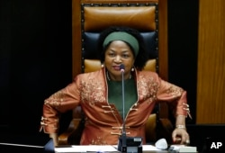 FILE - Speaker of the South African Parliament Baleka Mbete smiles during an answering of questions session by South African president Jacob Zuma, in Parliament, Cape Town, South Africa, March 11, 2015.