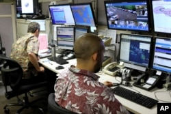 Hawaii Emergency Management Agency officials work at the department's command center in Honolulu on Dec. 1, 2017. A siren blared across Hawaii on Friday in an effort to prepare tourists and residents for a possible nuclear attack from North Korea.