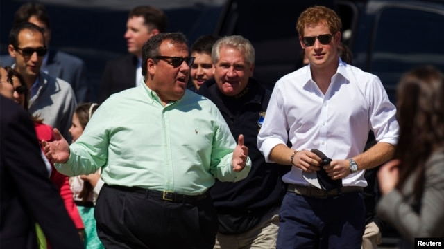 Britain's Prince Harry (R) walks with New Jersey Governor Chris Christie as they view areas of the boardwalk that have been repaired in Seaside Heights, a beach town hit by Hurricane Sandy last year, in New Jersey, May 14, 2013.