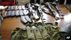 Some of the arms and ammunition recovered by police displayed in Nairobi, Kenya, September 14, 2012.