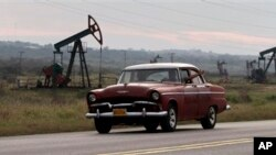 FILE - An old, U.S.- made car in Havana.