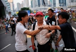 FILE - Protestors argue outside government offices in Hong Kong October 9, 2014.