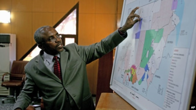 Azhari Abdalla, director general of the Sudanese oil ministry's Oil Exploration and Production Authority, points to a map as he briefs journalists in Khartoum, December 19, 2011.