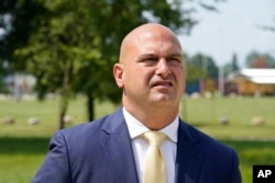 Dr. Nikolai Vitti, superintendent of Detroit Public Schools Community District, speaks during an interview outside Cody High School in Detroit on Friday, Aug. 20, 2021. (AP Photo/Carlos Osorio)