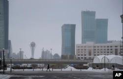 FILE - A resident walks in a street in Astana, Kazakhstan.