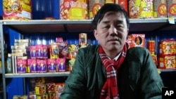 A fireworks seller in Beijing enjoys brisk trade as New Year celebrations get underway