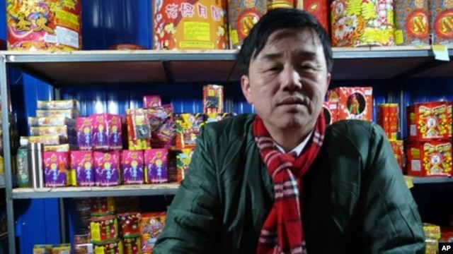 A fireworks seller in Beijing enjoys brisk trade as New Year celebrations get underway