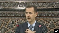 Syrian President Bashar al-Assad addresses the country's parliament in Damascus, March 30, 2011