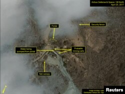 FILE - Commercial satellite imagery of the Punggye-ri nuclear test facility, which 38 North says indicates an apparent resumption of activity in North Korea, is seen in this image from April 25 released on May 3, 2017.