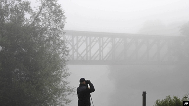 A member of the border police searches for illegal migrants on a railway bridge at the Schengen border with Croatia, June 20, 2011.