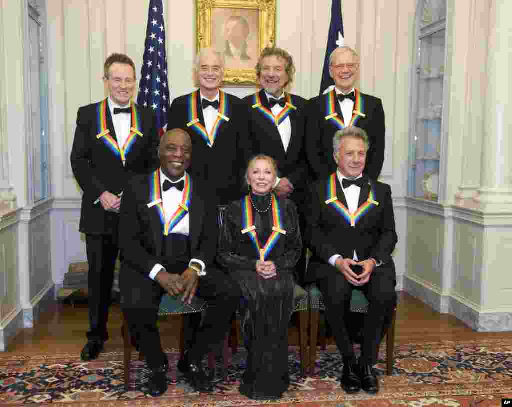 The 2012 Kennedy Center Honorees, from left, John Paul Jones, Buddy Guy, Jimmy Page, Natalia Makarova, Robert Plant, Dustin Hoffman, and David Letterman pose for a group photo, December 1, 2012.
