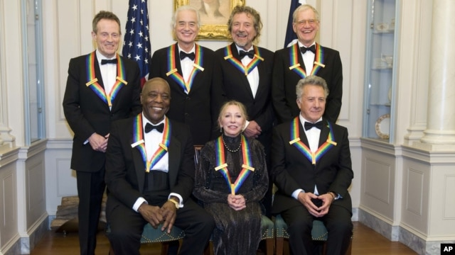 The 2012 Kennedy Center Honorees, from left, John Paul Jones, Buddy Guy, Jimmy Page, Natalia Makarova, Robert Plant, Dustin Hoffman, and David Letterman pose for a group photo, December 1, 2012 at the State Department in Washington.