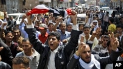Yemeni anti-government demonstrators chant slogans during a demonstration celebrating the resignation of Egyptian leader Hosni Mubarak and demanding the ouster of their own president, in Sanaa, Yemen, Feb 12, 2011